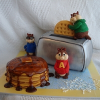Alvin & The Chipmunks I made this one for a friend after the first Chipmunks movie came out. The toaster and the waffles are cake, the figures are rice krispies...