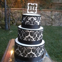Black And White Damask Wedding cake for my niece, I ordered a damask stencil and used royal icing.