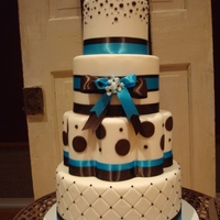 Teal, Brown And White Wedding My fav wedding cake to date! The bottom tier is the only one that is actual cake, they were not going to serve it.