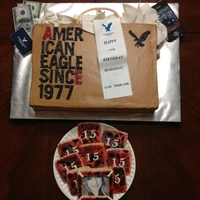 American Eagle Shopping Bag 2 layer sheet cake covered in buttercream, MMF tissue paper, edible image reciept and money, cookie iphone and ae gift certificate.