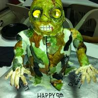"Zombie My son wanted a zombie cake for his birthday. ""Can you put lights in it's eyes mom?"". This is what I came up with. The body..."