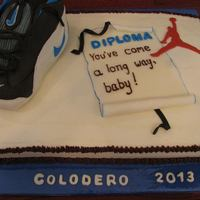 Graduation 2013 *Grandson loves shoes! This cake was modelled after his very first pair of Nike baby booties ... First time I carved a cake... Lots of fun...