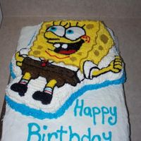 Sponge Bob Birthday 2 layer Spongebob cake. The bottom layer is yellow cake and the top layer (spongebob) is chocolate. All butter cream frosting.