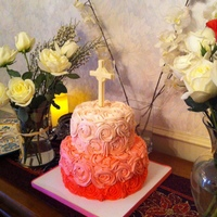 Rosette Christening Cake 6-9 inch red velvelt cake. Cream cheese frosting rosettes. White chocolate cross