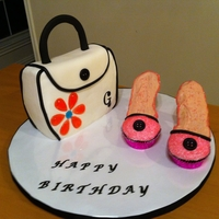 Purse And Cupcakes Shoes Purse cake is buttercream with fondant flap. Flower is jolly ranchers melted into jewel mold. Shoes are cupcakes with sugar cookie sole and...