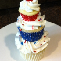 "Memorial Day Cupcake Tower This is a jumbo cupcake, regular cupcake and mini cupcake stacked for memorial day. The red ""cherry"" is just a cherry sour placed..."