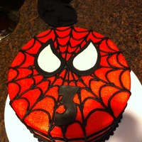 Spiderman 8 inch strawberry cake. Frosted in buttercream. Fondant eyes and number 3. I airbrushed the cake red instead of trying to color all that...
