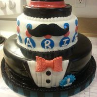 All Cake From Bottom Tear To The Top Hat Covered In Satin Ice Mustache And Bow Tie Made From Gum Paste And Fondant All cake from bottom tear to the top hat. Covered in satin ice. Mustache and bow tie made from gum paste and fondant.