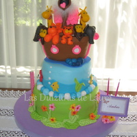 Ark For Ambar  Vanilla cake, filled with dulce de leche and chocolate cream, covered in fondant, with fondant acents. Ark is modeled in cold porcelain....