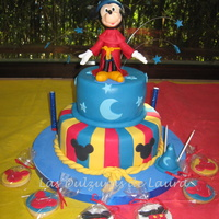 Fantasia - Mickey Vanilla with chocolate chips cake, filled with chocolate cream and dulce de leche, covered in fondant. Mickey i made of cold porcelain. TFL...