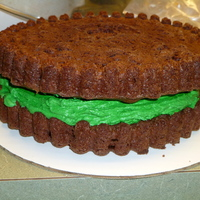 "Grasshopper Cookie Cake This cake is a big cookie cake pan. I used mint filling inside to make it a ""grasshopper"" cake"