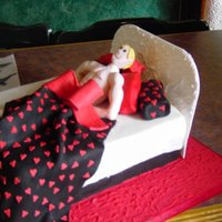 Muscle Man Sculpted man in fondant bed. Made for a hen night.