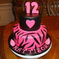 Mattison's Cake 10 and 6 inch tiers covered in fondant. Roses, heart, bead border and numbers were covered in hot pink sanding sugar. TFL