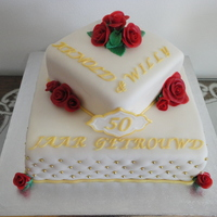 50 Years Of Marriage  sponge cake filled with raspberry jelly and champagne creme.covered in a 1:1 mixture of fondant and marzipan roses also made of the mixture...