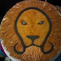 Leo Cake This was for a Leo party. Vanilla cake with chocolate bc. All fondant covered and painted. TFL