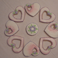 Bridal Shower Cookies NFSC covered with cookie glaze and decorated with royal icing piping, flower, leaves and dusted with luster dust.