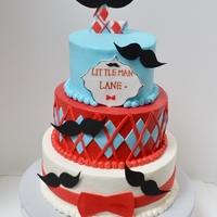Moustache Cake Buttercream icing with fondant accents
