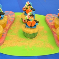 Penguin Beach Theme fondant penguins and chairs with accents, graham cracker topping for 'sand'