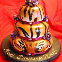 "The Eye Of The Tiger Tiger print cake. All the black and ""face"" are hand painted and the rest is airbrushed:)"