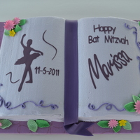 Purple Themed Bat Mitzvah Used the Wilton (2 cake mix) book pan. Placed 2 flower nails on each side of the book before baking. Gumpaste flowers