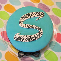 "Teal Zebra Print Cake  Tye dye cake covered with teal fondant. ""S"" is made from fondant then I hand painted zebra stripes (very easy, you can't..."