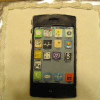 Iphone Cake  iphone is made of black fondant and each icon is hand painted using gel colors and vodka mixed like water colors on fondant. Placed on an...