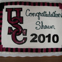 Usc Graduation Cake  The letters were cut out of fondant to mimic the USC logo. I cout them out in clack first then slightly smaller in burgandy. The only thing...