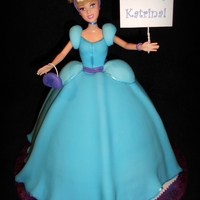"Cinderella Made for a little girl who loves Cinderella, blue and purple ;) Barbie doll in wonder mold with carved to fit 10"" round base cake."