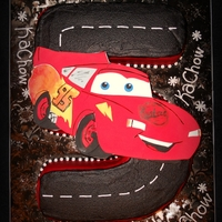 Lightning Mcqueen Race Track Fondant Lightning McQueen, buttercream on carved #5 cake.