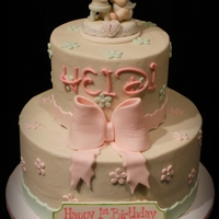 Precious Moments 1St Birthday & Dedication Topper was supplied. Fondant bow and details.