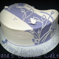 Purple With Butterflies Birthday Medium Paisley cake pan, chocolate chocolate chip cake with chocolate buttercream filling and vanilla buttercream and fondant details.