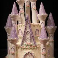 Princess Castle Made with Wilton's Romantic Castle Cake Set. 300 fondant flowers. Purple on turetts is RI covered with either cake sparkles, or disco...