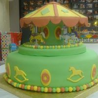 Merry Go Round chocolate cake covered with fondant and fondant designs. Merry go round is all fondant work except the horses are plastic. Thanks for...
