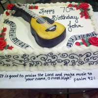 Guitar On Sheet Cake 12x16x3, half vanilla, half chocolate, filled with cookies and cream buttercream. Buttercream icing, RKT guitar covered in MMF.