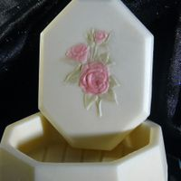 Close Up Of Small Box Molded in white chocolate, the entire box has been dusted in Wilton white pearl dust. the flowers are dusted in pink pearl dust and leaves...