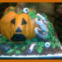 Halloween Cake Jack O'Lantern cake with severed finger, mummy hand, mouse and eyeballs