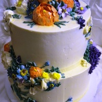 Buttercream Wedding Cake It was a surprise wedding! The bride and groom surprised their guest with a wedding! All flowers are buttercream and piped right onto the...