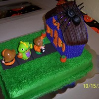Little People Halloween This cake was done for a little girl's birthday. It had everything she loves....Little People, Halloween and Spiders.