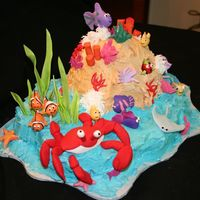 Under The Sea This cake was so much fun to do! It was for my cousin's daughter who is a HUGE fish fan. The reef and water is all cake; the rest is...