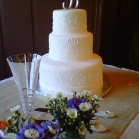 Classic Hand Piped Wedding Cake Just lovely for a country wedding in Ft. Mitchell, Alabama. Fondant with buttercream piping.