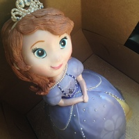 A Princess Sofia Cake Made From Rice Krispy Treats Modeling Chocolate And Fondant The Dress Is Made Of A Chocolate Brownie Cake With Dark  A Princess Sofia cake made from rice krispy treats, modeling chocolate and fondant. The dress is made of a chocolate brownie cake with dark...