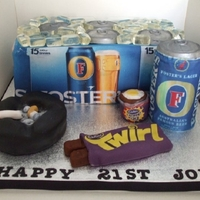 Fosters Beer Cake This cake was all the things that the birthday boy likes. The beer bucket, can and ashtray are cake and the creme egg and twirl chocolates...