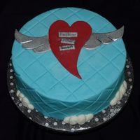 Follow Your Heart I made this cake for one of my daughter's teachers who was moving away for love. Iced in BC with fondant heart & wings. I think...