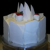 White Chocolate Shard Cake   Cake with white chocolate shards and chocolate dipped strawberries.