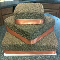 Square Wedding Cake The bride wanted brown with orange ribbon... BC rosettes with satin ribbon.