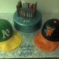 Baby Shower/baseball Cake This was for a friends baby shower. The mother is an A's fan, the father is a Giants fan. The crib and elmo are made out of gum paste...