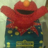 "Elmo Birthday Cake Elmo is crafted out of rice krispies treats, covered in fondant, piped buttercream ""fur"". It is a vanilla bean confetti cake with..."
