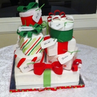 Christmas Packages 10 packages for an office party, one for each staff member to take home the big one on bottom to eat at the party.