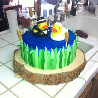 Duckie's In Love all fondant with plastic rubber duckies, the base is a real tree stump