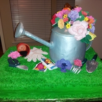 Watering Can Cake Watering can cake made for the Central EMS Auction - Watering can made of rice crispy treat covered with candy clay and fondant. Sugar...
